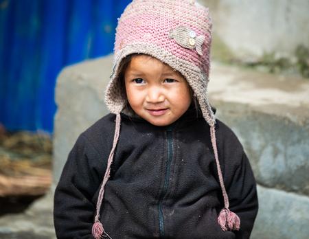 GHALEGAUN, NEPAL - CIRCA MAY 2018: Young Nepali girl wearing a pink cap.