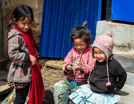 GHALEGAUN, NEPAL - CIRCA MAY 2018: Three young Nepali girls playing outside their home. Sajtókép