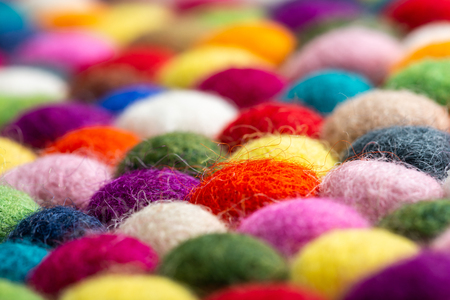 Multicolored felt ball rug detail, colorful texture 写真素材