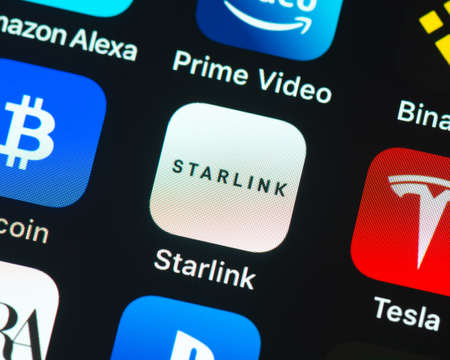 BAYONNE, FRANCE - CIRCA JANUARY 2021: Starlink app icon on Apple iPhone screen. Starlink is a satellite internet constellation being constructed by SpaceX to provide satellite internet access.