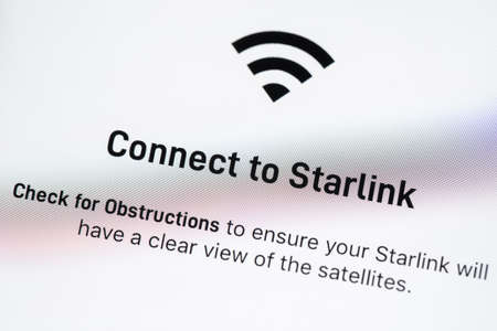 BAYONNE, FRANCE - CIRCA FEBRUARY 2021: Starlink app on Apple iPhone screen. Starlink is a satellite internet constellation being constructed by SpaceX to provide satellite internet access.