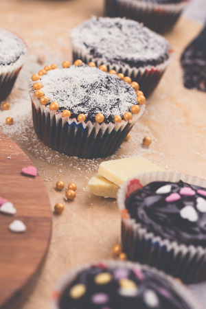 Tasty homemade muffins with black and white chocolate