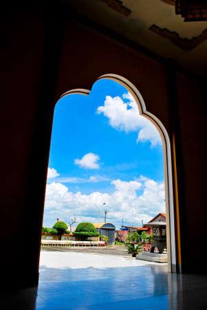 main gate: Blue sky outside main gate of An Chau Church, An Giang, Mekong delta, Vietnam Stock Photo
