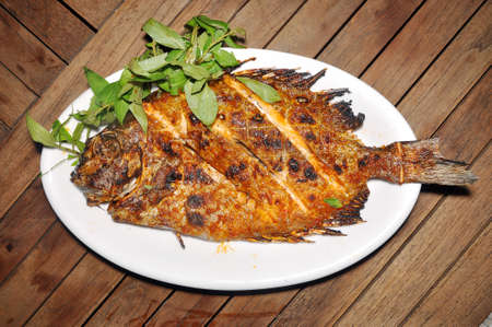 rabbitfish: Grilled rabbitfish on a dish on the table in restaurant