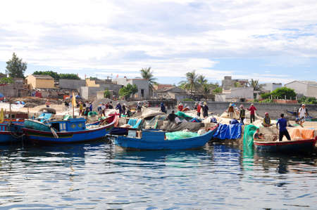 ly: LY SON, VIETNAM - JULY 31, 2012: Fishermen are working in a seaport at Ly Son island in Quang Ngai province, Vietnam