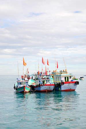 Fishing boats are mooring
