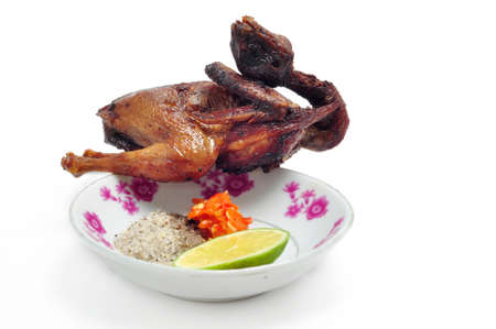 Vietnamese grilled quail on a white background 版權商用圖片