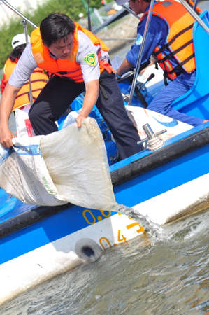 HO CHI MINH CITY, VIETNAM - APRIL 24, 2015: Fishes are kept in plastic bags preparing to be released in the Saigon river in the National Fisheries day in Vietnam Editorial