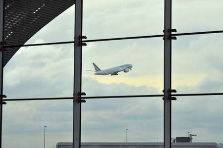 charles de gaulle: PARIS, FRANCE - NOVEMBER 5, 2011: A plane is taking off from Charles de Gaulle airport Editorial