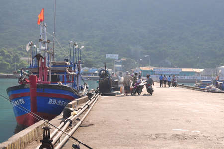 CON DAO, VIETNAM - JULY 2, 2012: An overview at the seaport of Con Dao island with fisherman and fishing boats parking