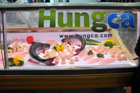 countervailing duty: HO CHI MINH CITY, VIETNAM - JUNE 25, 2013: Pangasius catfish product is being show in the Vietfish seafood Exhibition in Saigon