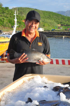 exported: NHA TRANG, VIETNAM - JUNE 23, 2013: Barramundi fish are farmed in the Van Phong Bay and exported to the world market