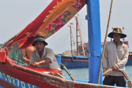 VUNG TAU, VIETNAM - MARCH 15, 2012: Fishermen on a fishing boat are ready to go offshore for a better source of fishes