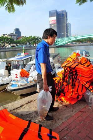 fresh water aquarium fish: HO CHI MINH CITY, VIETNAM - APRIL 24, 2015: Fishes are kept in plastic bags preparing to be released in the Saigon river in the National Fisheries day in Vietnam Editorial