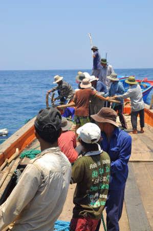 trawl: NHA TRANG, VIETNAM - MAY 5, 2012: Fishermen are trawling for tuna fish in the sea of Nha Trang bay in Vietnam