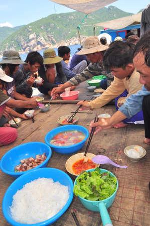 trawl: NHA TRANG, VIETNAM - MAY 4, 2012: Lunch of fisherman on the tuna fishing boat in the sea of Nha Trang Bay