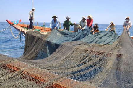 NHA TRANG, VIETNAM - MAY 5, 2012: Fishermen are trawling for tuna fish in the sea of Nha Trang bay in Vietnam