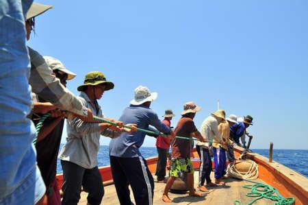 trawl: NHA TRANG, VIETNAM - MAY 5, 2012: Fishermen are catching tuna with a trawl net.