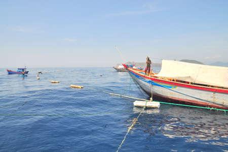 shrimp boat: NHA TRANG, VIETNAM - MAY 4, 2012: Fishing boats are preparing to trawl in the sea of Nha Trang bay in Vietnam