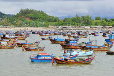 NHA TRANG, VIETNAM - OCTOBER 5, 2011: Fishing boats are mooring in a seaport of Nha Trang Editorial