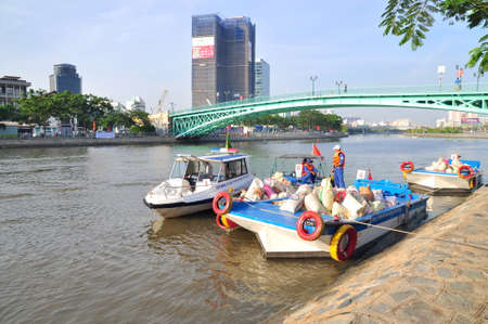pollution free: HO CHI MINH CITY, VIETNAM - APRIL 24, 2015: Preparing to release fishes in the Saigon river in the National Fisheries day in Vietnam