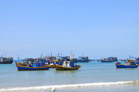forage fish: LAGI, VIETNAM - FEBRUARY 26, 2012: Local fishing boats are mooring in the Lagi beach Editorial