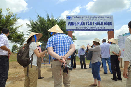 pangasius: DONG THAP, VIETNAM - MARCH 1, 2013: International reporters and journalists are about to enter a pangasius catfish farm in the mekong delta of Vietnam