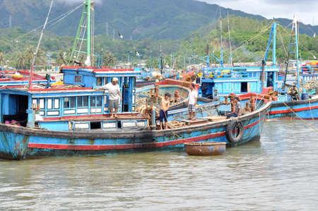 NHA TRANG, VIETNAM - OCTOBER 5, 2011: Fishing boats are mooring in a seaport of Nha Trang Sajtókép