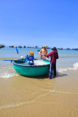 LAGI, VIETNAM - FEBRUARY 26, 2012: Local fishermen are preparing their fishing nets for a new working day in the Lagi beach Sajtókép