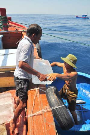 NHA TRANG, VIETNAM - MAY 4, 2012: Transferring supplements from land to fishing boats in the sea of Nha Trang bay