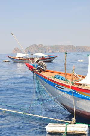 NHA TRANG, VIETNAM - MAY 4, 2012: Fishing boats are preparing to trawl in the sea of Nha Trang bay in Vietnam