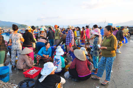 local supply: NHA TRANG, VIETNAM - OCTOBER 5, 2011: Women are selling fresh fishes at a local seafood market in Vinh Luong port Editorial