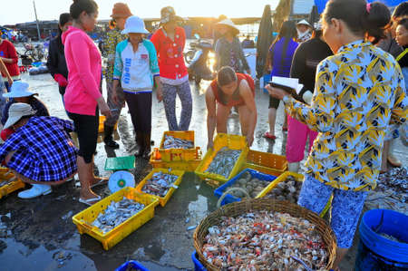 NHA TRANG VIETNAM  OCTOBER 5 2011: Women are selling fresh fishes at a local seafood market in Vinh Luong port Sajtókép