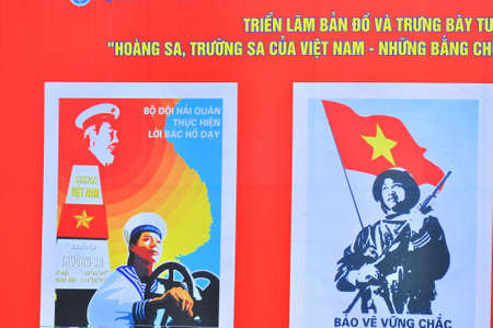 against the war: Nha Trang, Vietnam - July 11, 2015: A propaganda poster about protecting the Spratly islands in the square in Vietnam Editorial