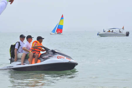 jetski: Nha Trang, Vietnam - July 11, 2015: Preparing the jetski for travellers on the beach of Nha Trang city