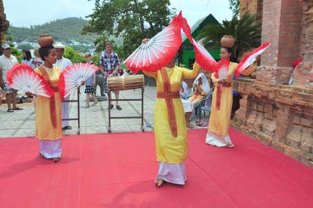 champa flower: Nha Trang, Vietnam - July 11, 2015: Performing of a traditional folk dance of champa at the Ponagar temple in Nha Trang