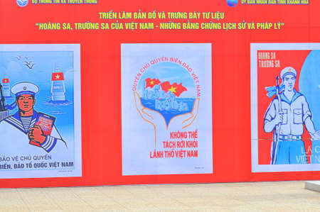 propaganda: Nha Trang, Vietnam - July 11, 2015: A propaganda poster about protecting the Spratly islands in the square in Vietnam Editorial