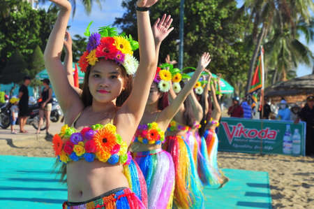 polynesia: Nha Trang, Vietnam - July 14, 2015: Young girl dancers are performing a sport dance on the beach of Nha Trang city Editorial