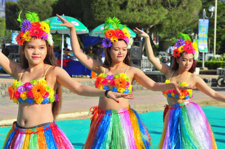 student travel: Nha Trang, Vietnam - July 14, 2015: Young girl dancers are performing a sport dance on the beach of Nha Trang city Editorial