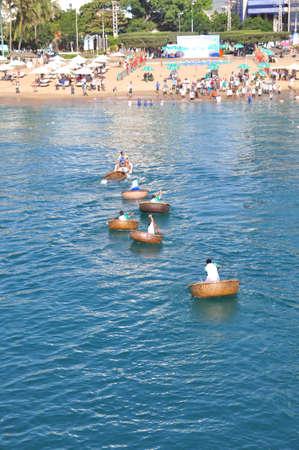 Nha Trang, Vietnam - July 14, 2015: Fishermen are racing by basket boats in the sea of Nha Trang bay Editorial