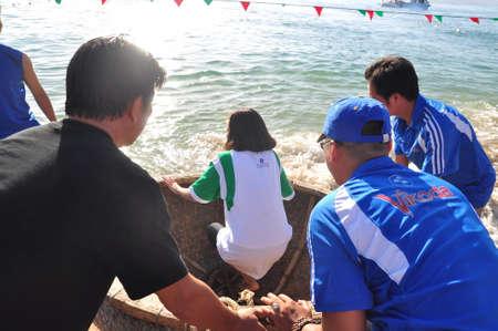Nha Trang, Vietnam - July 14, 2015: Fishermen are ready for a basket boat racing in the sea of Nha Trang bay