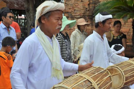 Nha Trang, Vietnam - July 11, 2015: Two old men are performing the traditional drums technique of champa at the Po Nagar temple in Nha Trang Editorial