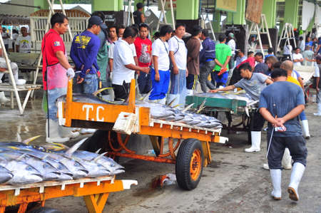 bargaining: General Santos, Philippines - September 5, 2015: Sellers anf buyers are bargaining for tuna at the seafood market