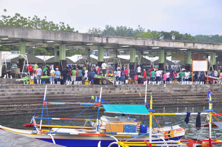 fisheries: General Santos, Philippines - September 5, 2015: many people are trading fisheries at the seaport