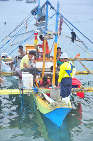 thunnus: General Santos, Philippines - September 5, 2015: Philippines fisherman are working on a fishing boat Editorial