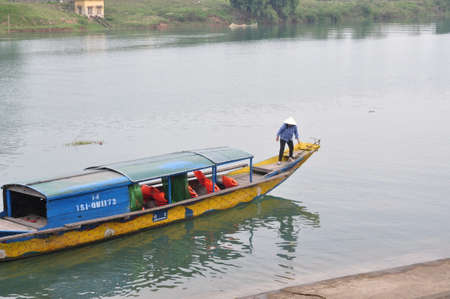 Quang Binh, Vietnam - October 23, 2015: A local woman is taking tourists to travel on her traditional small boat