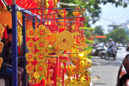 laterns: Nha Trang, Vietnam - February 7, 2016: Red lanterns, lucky money and lucky items are for sale in the lunar new year on the street of Vietnam