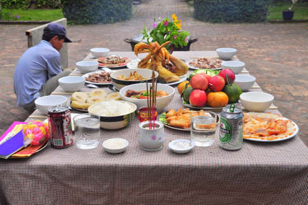 holiday food: Nha Trang, Vietnam - February 5, 2016: Vietnamese worship tray of foods in the lunar new year Editorial