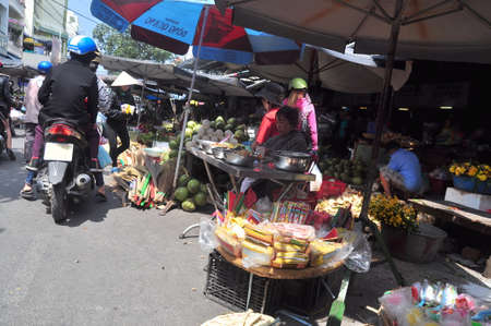 scamper: Nha Trang, Vietnam - February 7, 2016: Plenty of household appliances are for sale in a street market in Vietnam Editorial