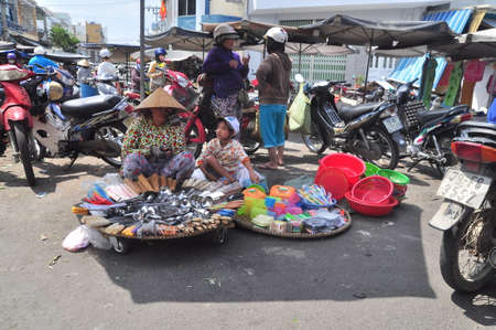 scamper: Nha Trang, Vietnam - February 7, 2016: Plenty of things are for sale in a street market in Vietnam